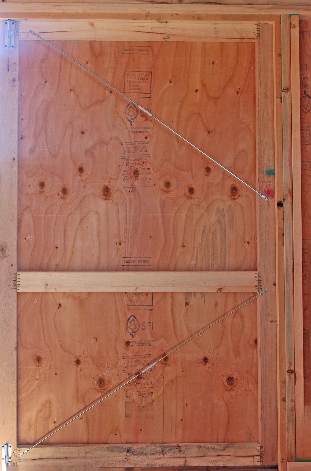 Adjustable wood door brace