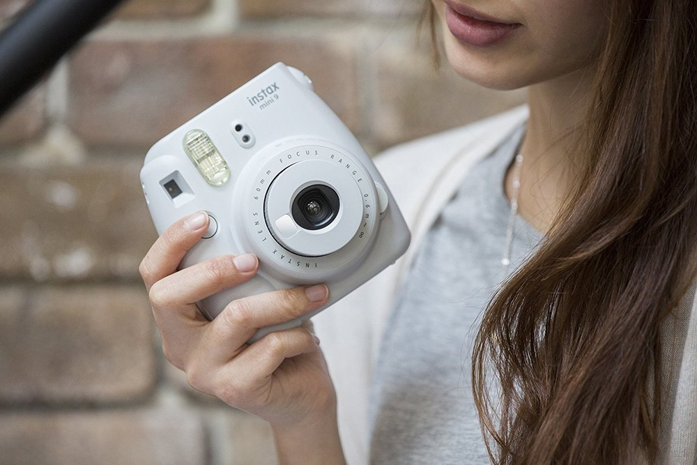 Woman holding a white Instax Mini 9