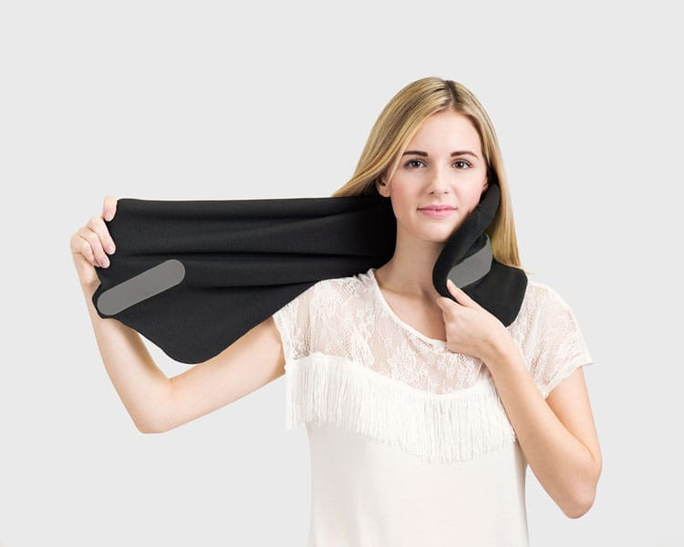 Woman assembling Trtl pillow