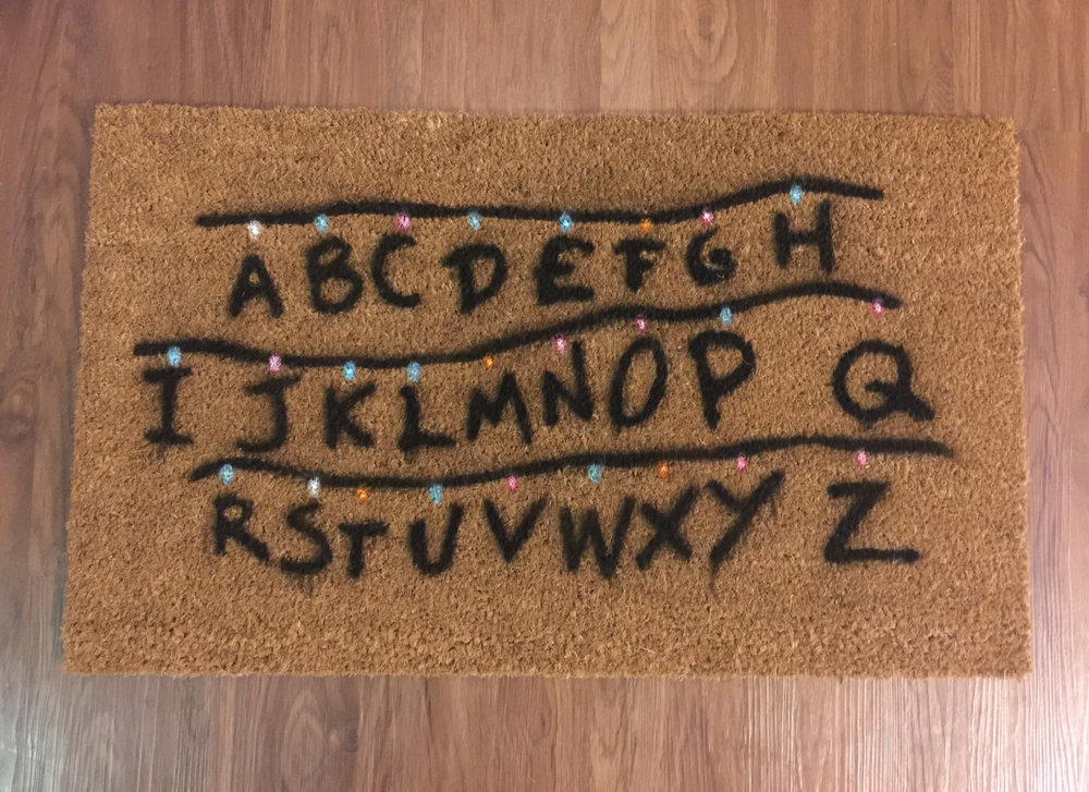 Stranger Things doormat in the style of Joyce's living room lighting when she is trying to connect with will