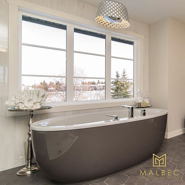 There's nothing better than coming home to a luxurious bathroom for a relaxing bath and maybe a glass of wine, especially with snow flying. If you're ready to upgrade your bathroom give us a call at 403-999-1900 for a free consultation and let's create a stunning space together. #malbechomes #creatingstunningspaces #customrenovations #customhomes #masterensuite