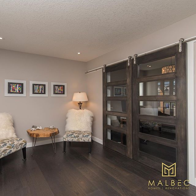 One of the best parts of a major renovation is being able to dictate exactly what happens to each square foot of your home. Although the kitchen and a living room may get the most use having a space designed for you can often make the biggest impact. Like this beautiful seating area for visiting or reading in quiet, accentuated by these beautiful custom sliding doors. #malbechomes #creatingstunningspaces #customrenovations #yycliving #luxurycalgary