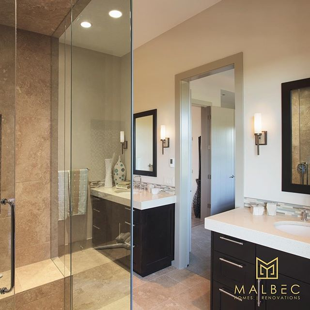 Dual vanity's and a custom stand up shower create a beautiful and functional master ensuite. If you're ready to make your dreams a reality contact Malbec Homes at 403-999-1900 for a free consultation today. #malbechomes #customrenovation #masterensuite #custombathroom #yycliving #creatingstunningspaces #luxurycalgary