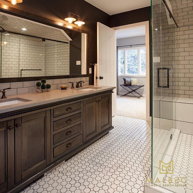 A gorgeous double vanity and large custom shower making starting every day a dream. Visit malbechomes.com to find out more. #malbechomes #creatingstunningspaces #yycliving #luxurycalgary #customrenovations