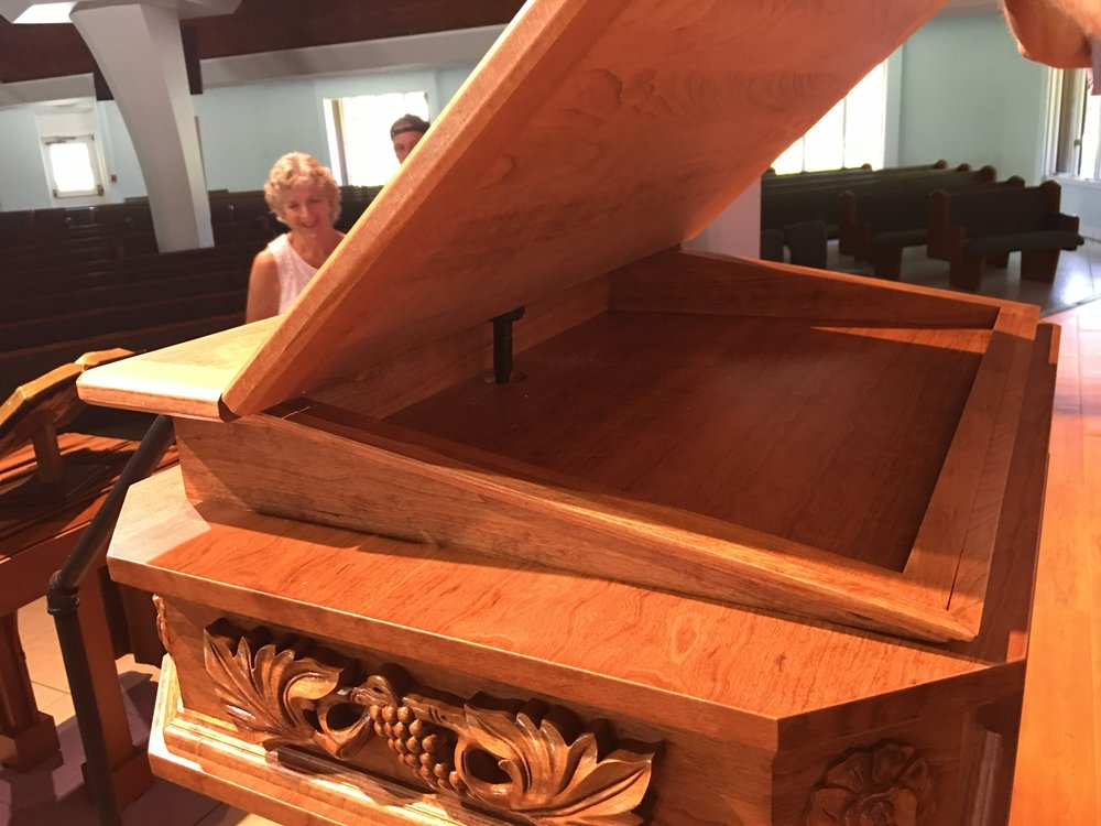 New pulpit opens up for convenient storage