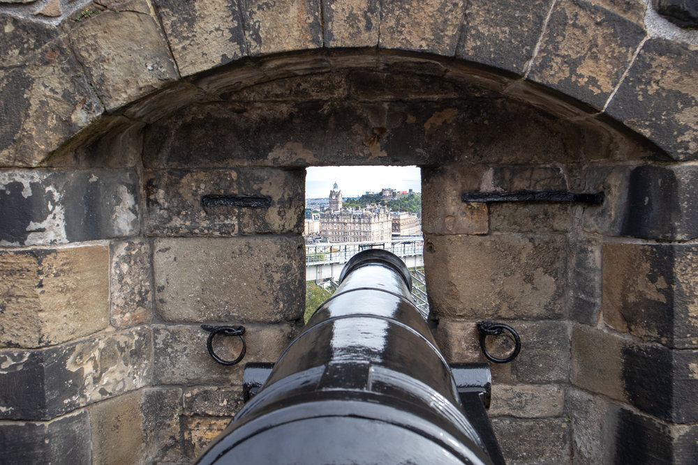 The rocky castle fortress of Edinburgh Castle in Scotland. Learn all my travel tips for how to save money on your honeymoon! | MissFunctional Money