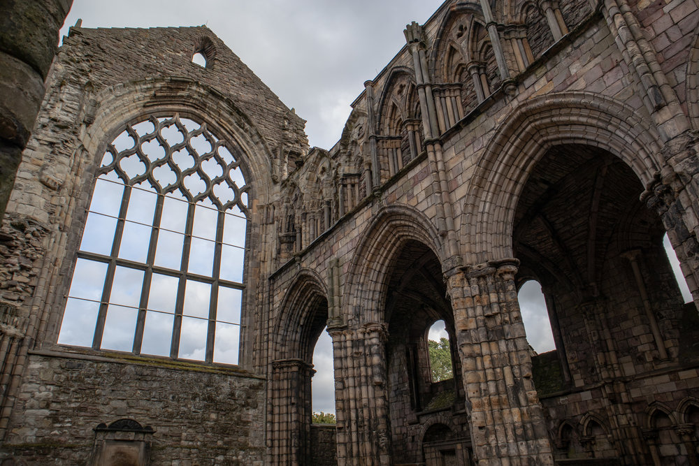 Abbey ruins at The Palace of Holyroodhouse in Edinburgh, Scotland. Learn how to save money on your trip!