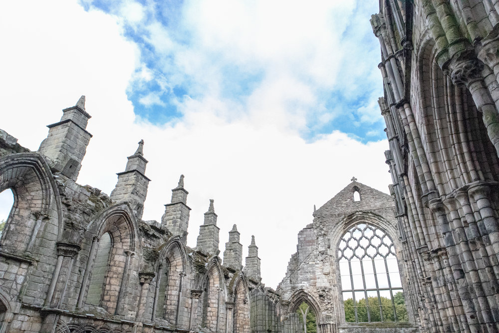 The ruined abbey at the Palace of Holyroodhouse in Edinburgh, Scotland. Learn how to save more money when you go to Europe!
