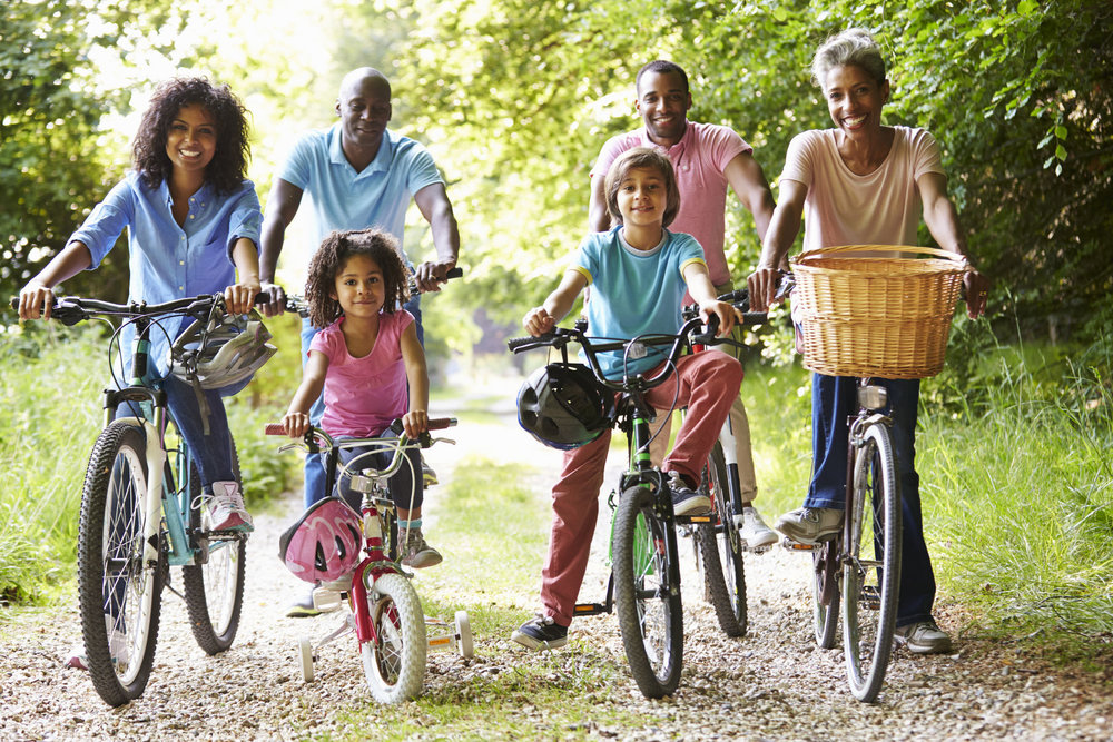 Healthy Family Outdoors Riding Bicycles