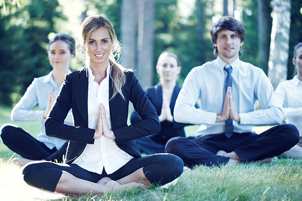Business People Outside Practicing Yoga Poses