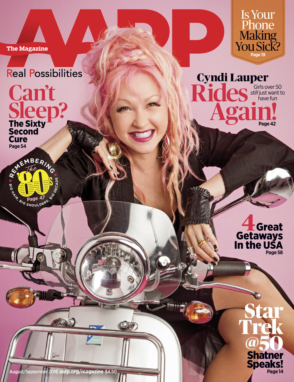 "Lauper DID NOT want to get on the scooter originally ( Caitlin Peters , OUR Photo editor, coerced her).  it was the last take of the day and she lit up on it. She was quoted SAYING ""the head of AARP liked motorcycles"" in an interview. I'm certainly not the head of AARP but glad she hopped on :) The lighting on this shoot (by  Jim Wright ) was great, very little photoshop clean up on our part. We seriously try not to do too much."