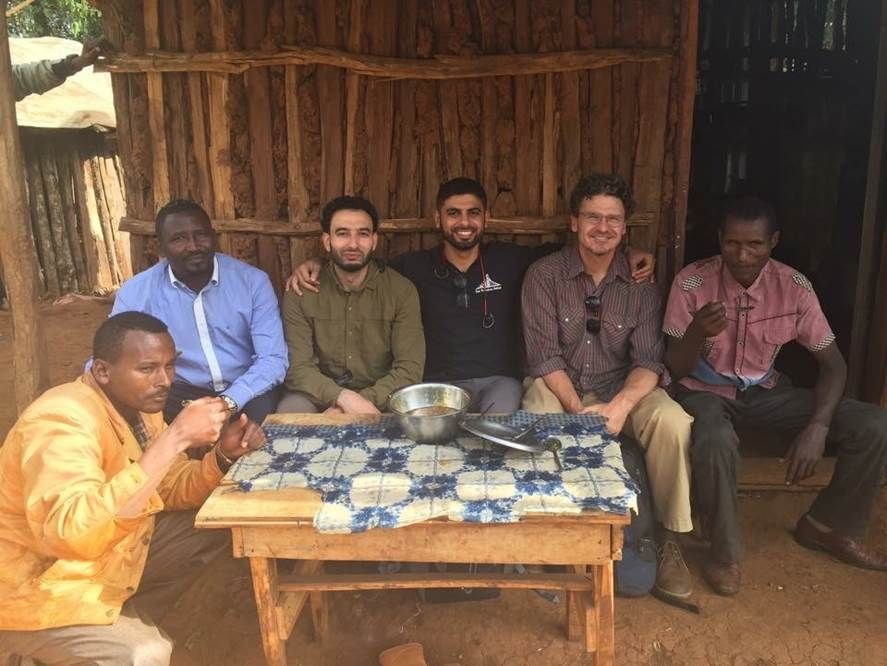 Mokhtar, Dave, and friends in Ethiopia at the Guji Highland coffee farm, where they also harvest honey.