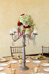 Antique candelabra with antique hydrangea, black bacarra roses, amaranthus, fugi mums and gold votives and crystals