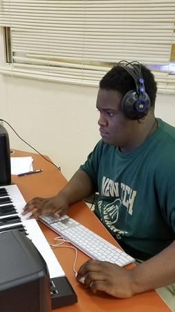 Lamarr Thompson, 17, works on a song during a music production class at the Gary Career Center. (Carole Carlson / Post-Tribune)