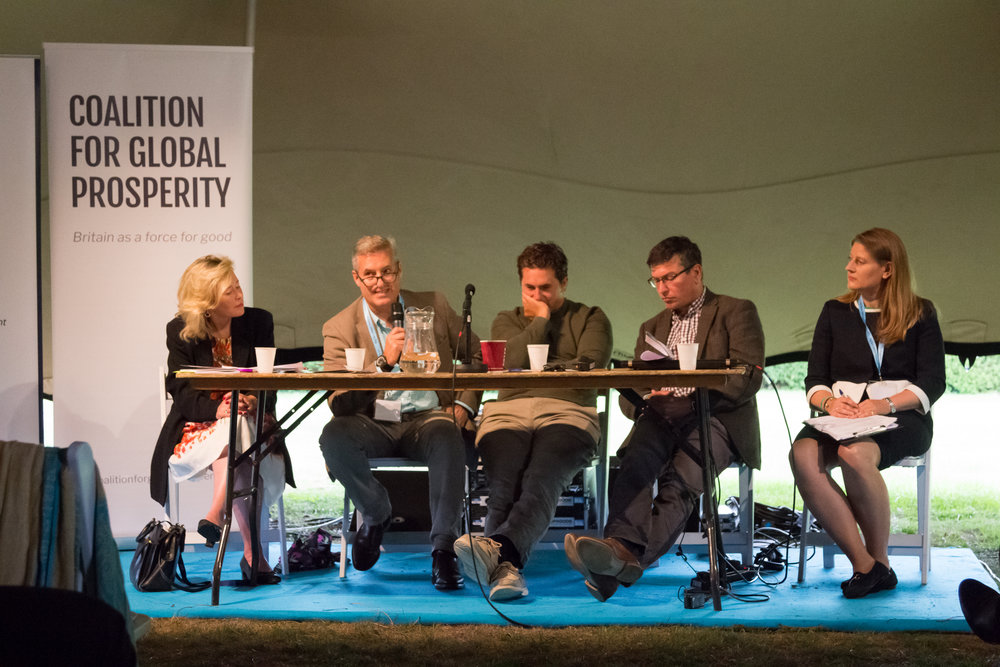 """The Role of Hard Vs Soft Power'    in the Global Britain Tent at the     Big Tent Ideas Festival 2018    . From left to right:    Baroness Julie Smith, Lt Gen Phil Jones, Johnny Mercer MP   ,    Tom Cargill   , Director of the British Foreign Policy Group &    Theo Clarke   , Founder & Chief Executive of the Coalition for Global Prosperity"