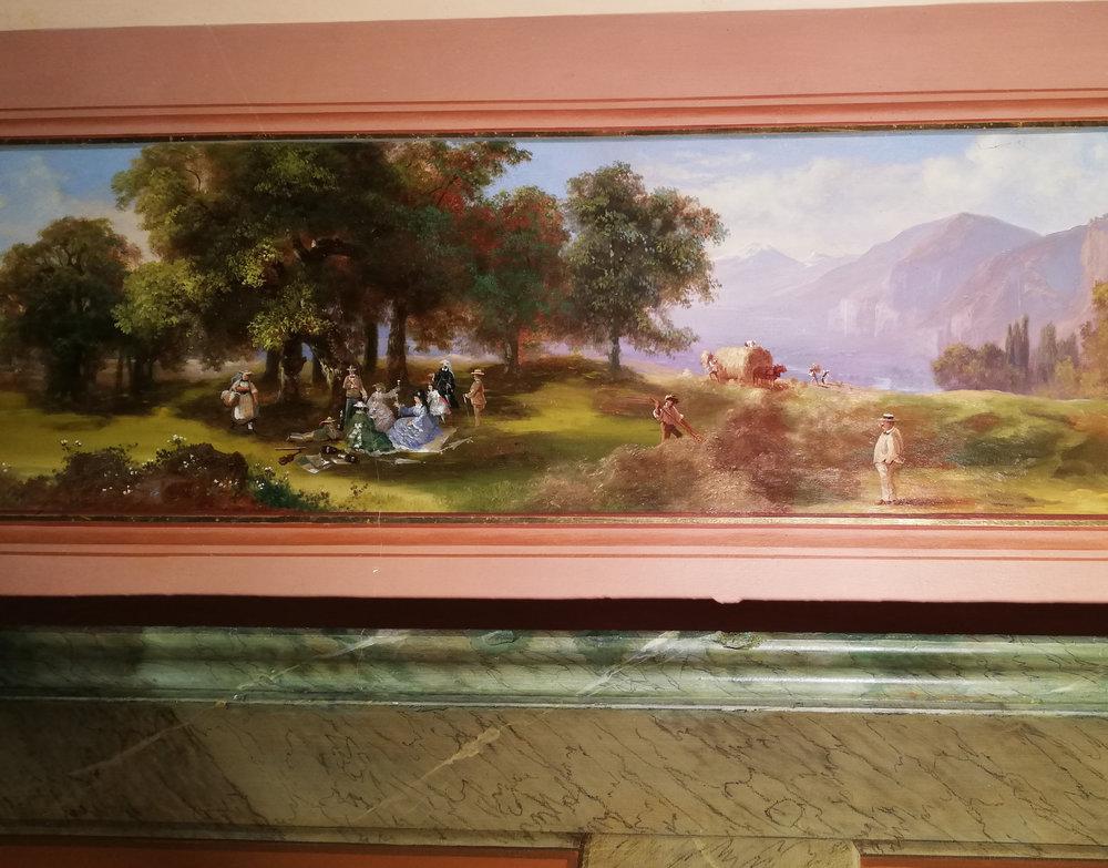 Détail de la frise de Arnold Jenny, peinte paysagiste bâlois (1831-1881), dont les paysages évoquent les 4 saisons, et cette scène en particulier un pique-nique de la famille Borel (probablement)