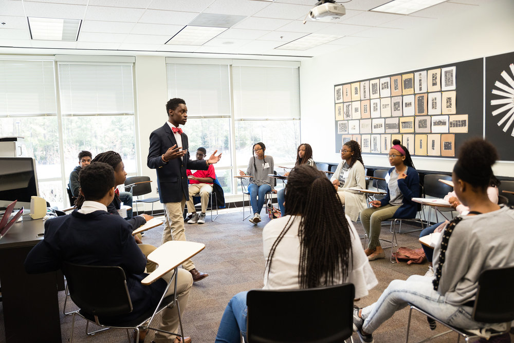 (Pictured: Osazi teaching debate to students in the Atlanta community.)