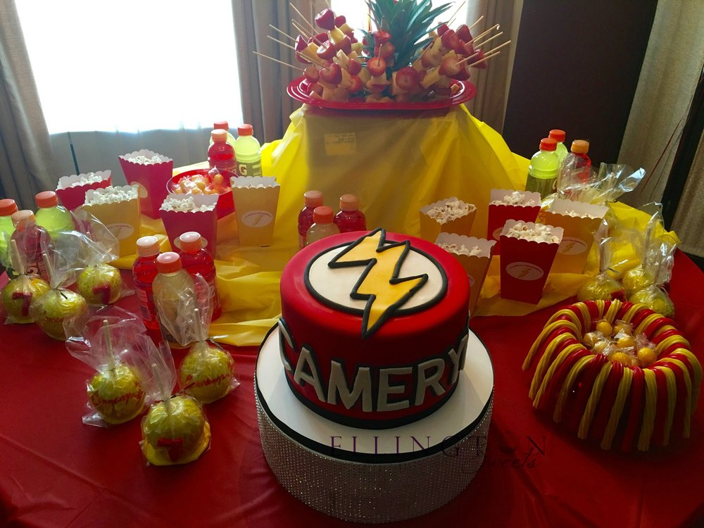 Cameryn_s Flash themed birthday cake set up.jpg
