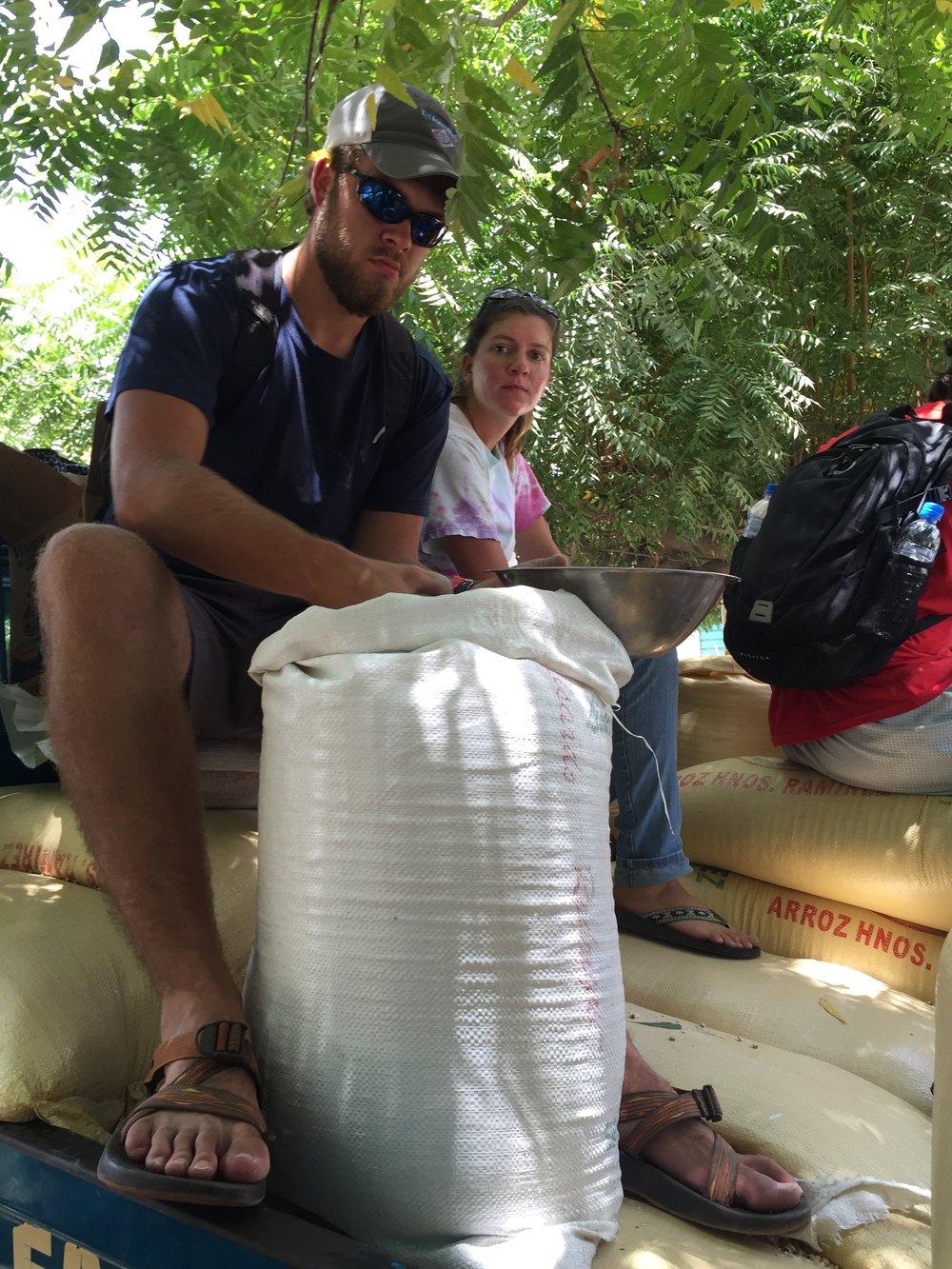 The Dominican Republic - Hayden Sistrunk preparing feed sack in the Dominican Republic.