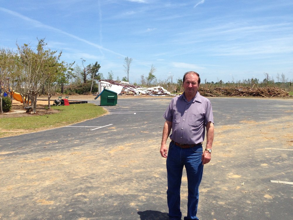 Louisville, MS Tornado - Harvey Ranier surveying damage after Louisville, MS tornado.  Delivered trailer load of supplies to South Louisville Baptist Church.