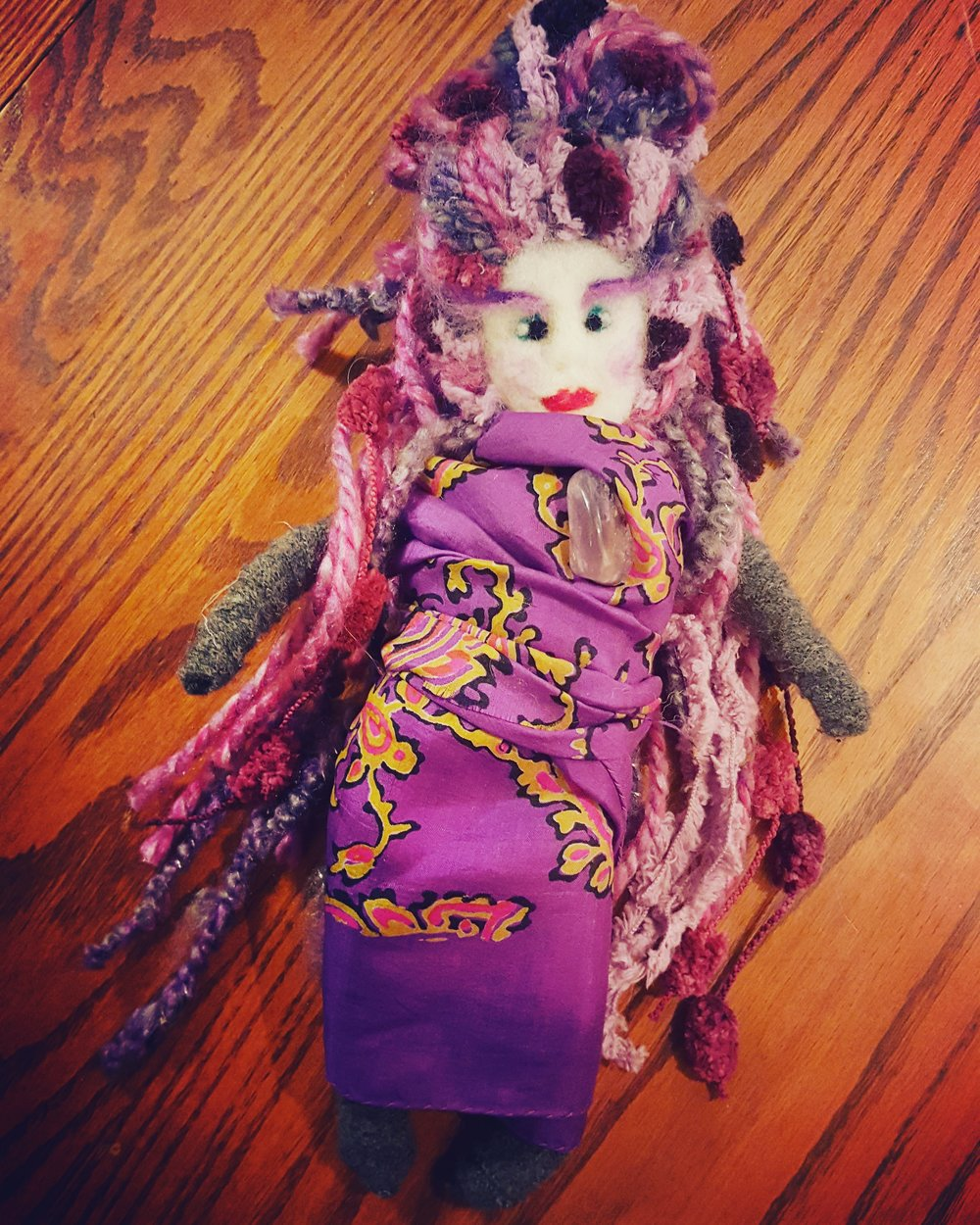 For ENN. - This dollie was made with love for ENN.The color purple combines the stability of blue with the fiery energy of red. Purple is the color of peace, wisdom, magic and independence. The amethyst stone on her heart encourages the healing process.May this doll bring love and light.