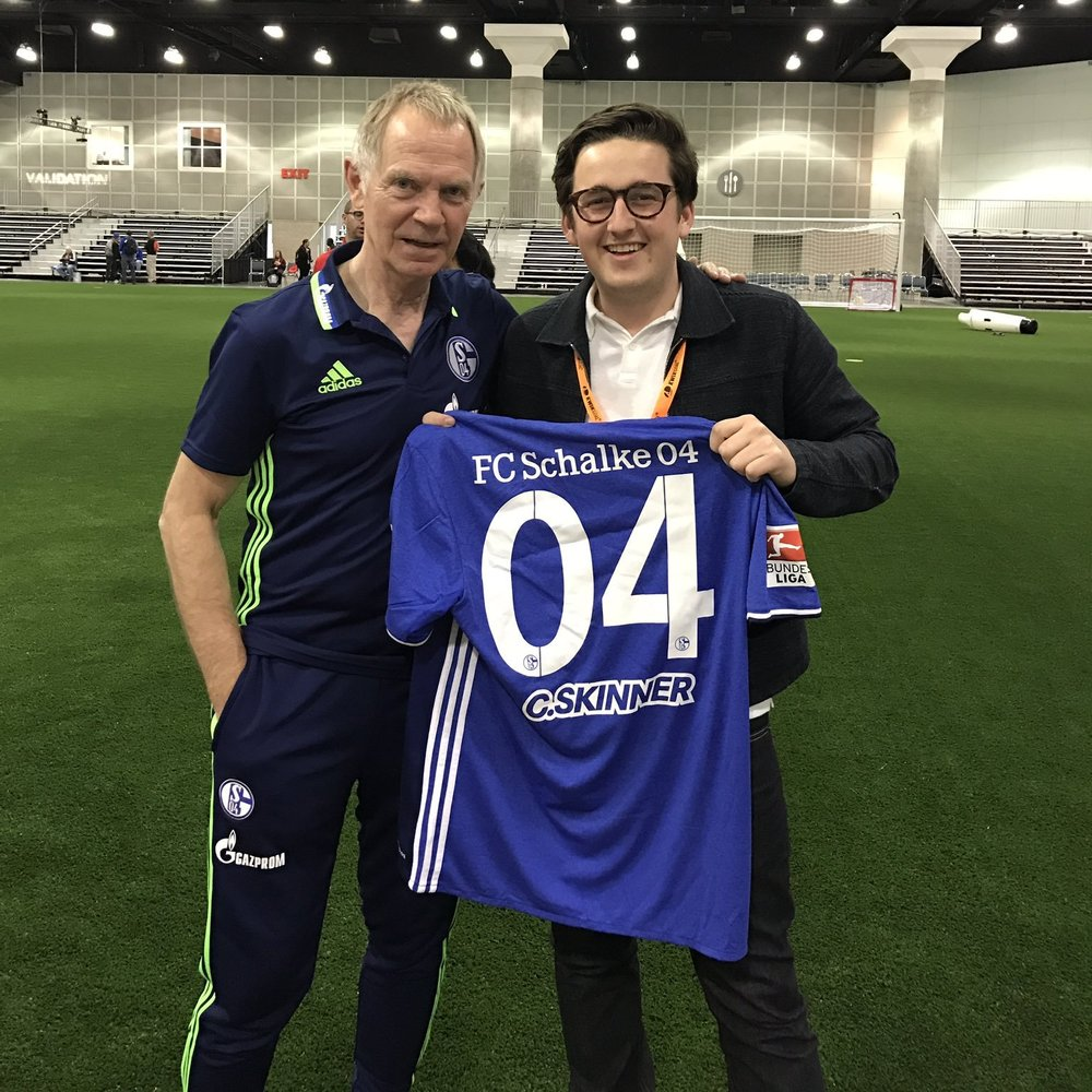 Bodo Menze presents GloballCoach's Ciaran Skinner with a shirt from Schalke 04.