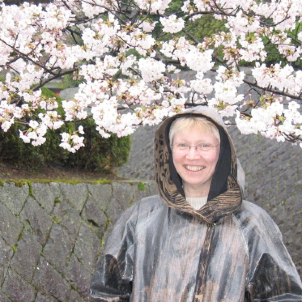 The artist in Japan - wearing the raincoat that inspired the collection.