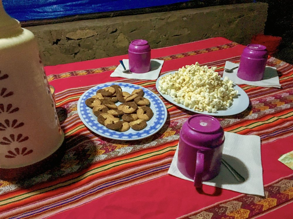 The nightly pre dinner spread of popcorn, cookies and tea.