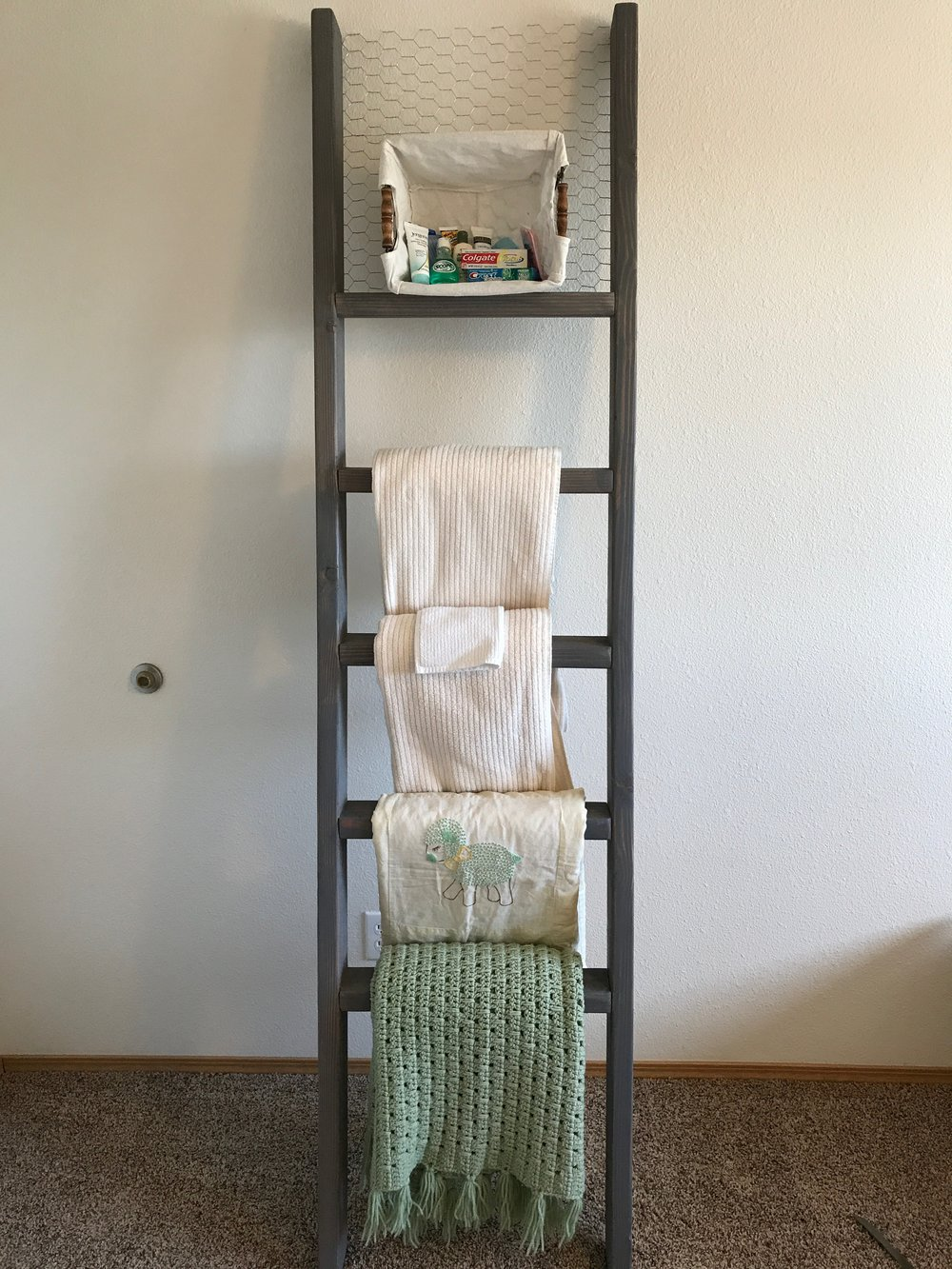 - I decided that I wanted to have a basket on the top to put travel sized bathroom essentials since it was for the guest room. We stapled chicken wire to the top and i was able to hang the basket from the wire. Later on down the road I will be clothes pinning black and white photos above the basket. All in all I enjoyed my first wood working project and look forward to more in the future! Let me know if you great one as well and how it turned out!