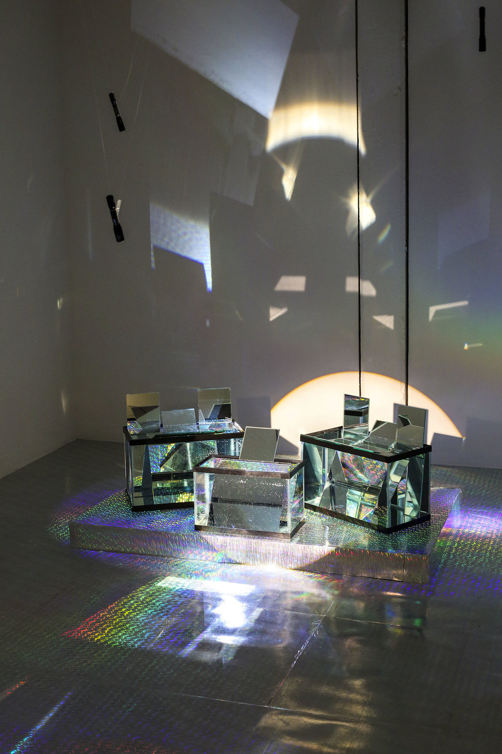 Intra-spectrum    2016  Fish tanks, water, mirrors, Rainbow paper, LED lights  Installation size contingent on space.