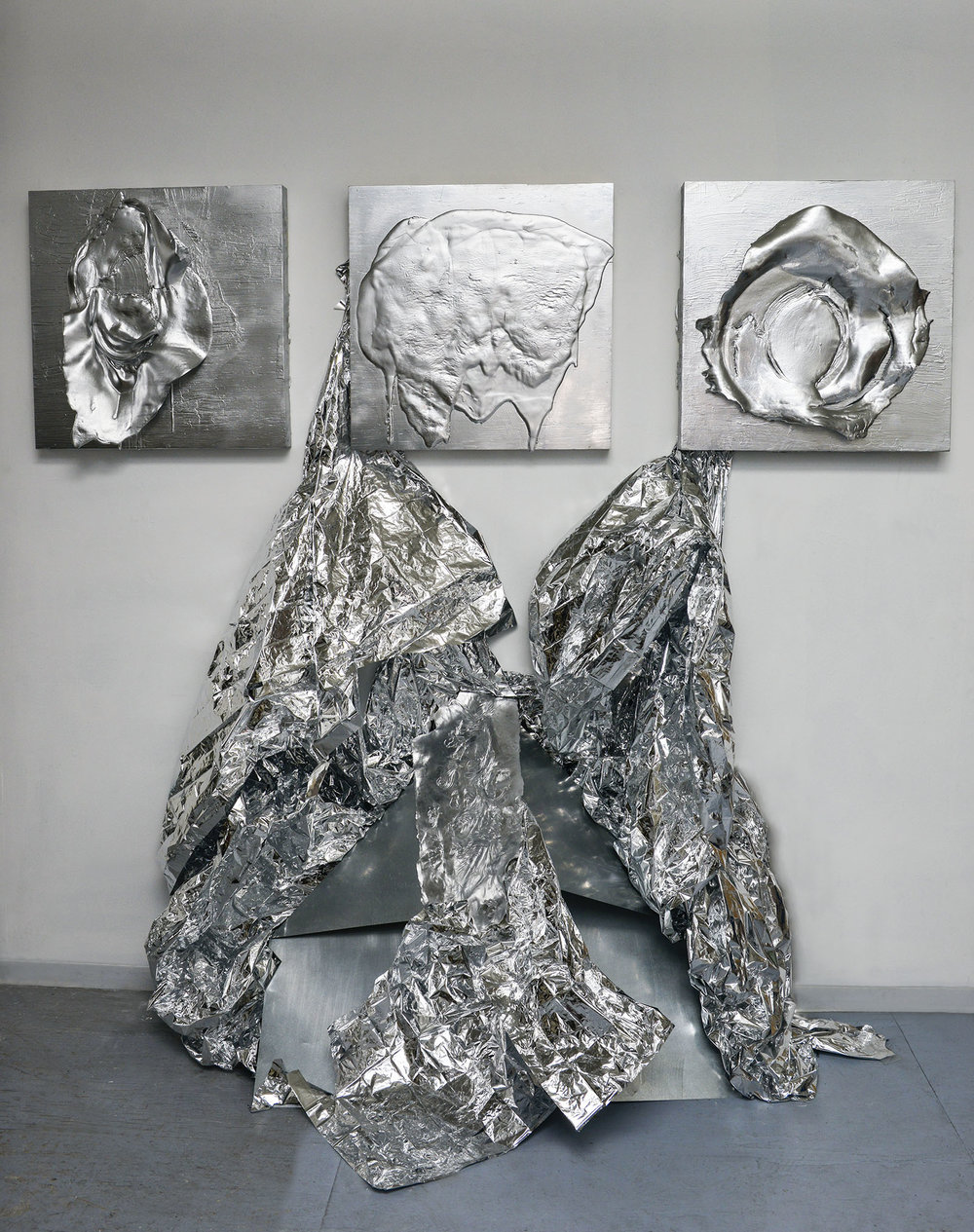 "Alchemic Transmutation    Latex, plaster, spray paint on wood panel (installation: aluminum, mylar, plaster, canvas).  (Tryptic) each 24""x 24""  2015."