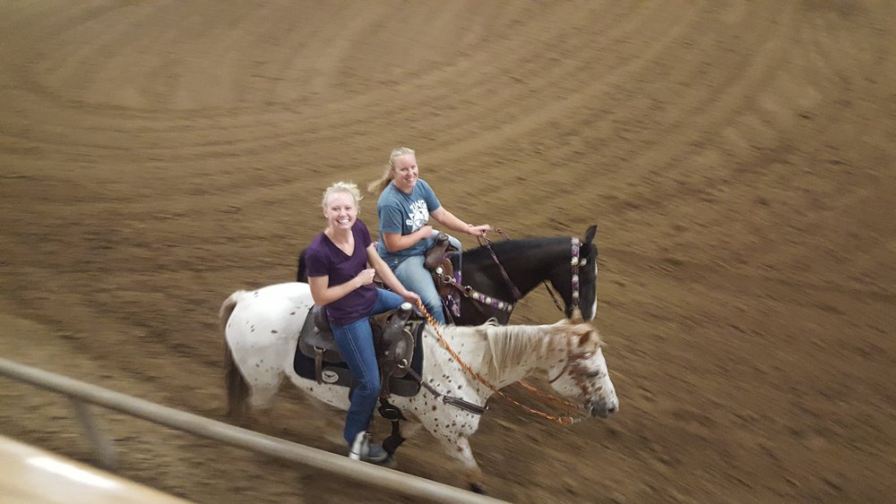 Alumni Angela Robertson (left) and Krista Goosman (right) warm up before their ride