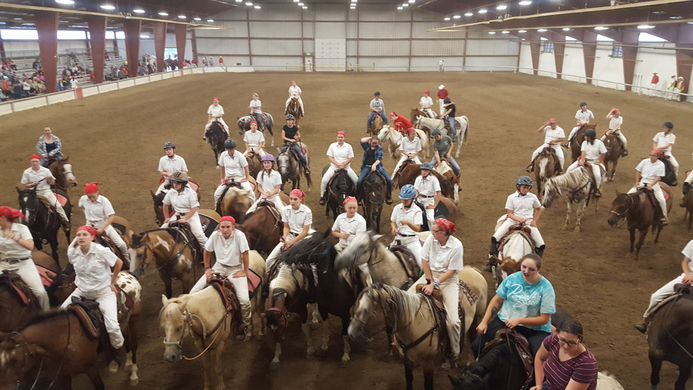 Crimson Rangers alumni and current riders hear some announcements and cool out their horses after an excellent ride
