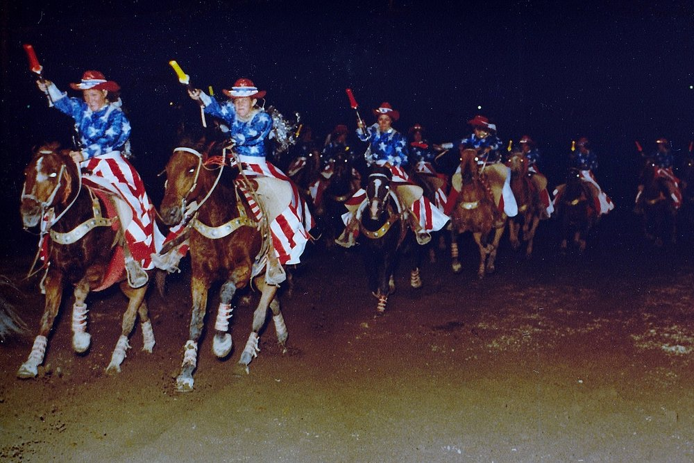 Varsity Red Team Pass in Review as they exit the arena at the Festival of the West in 1980.