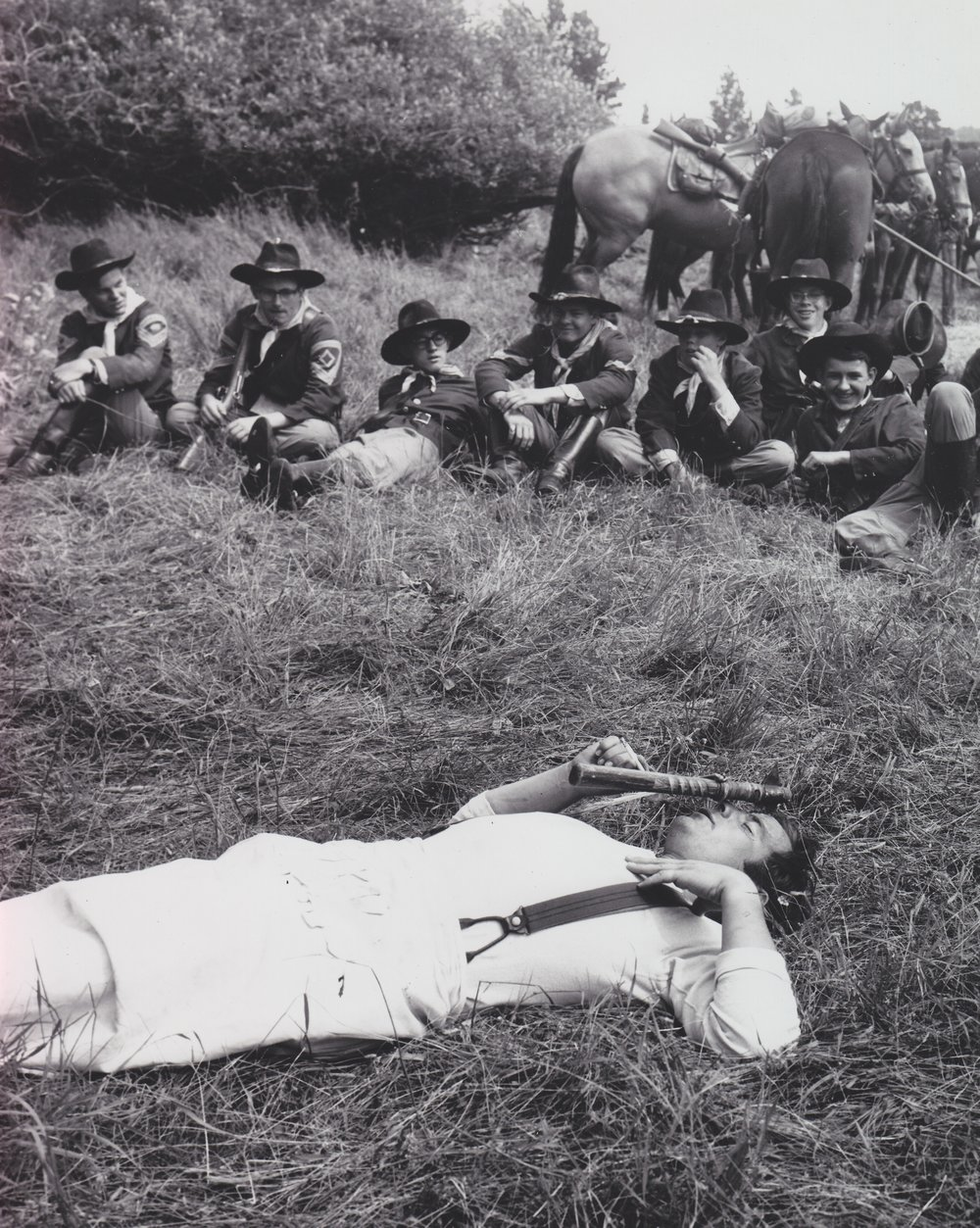 A settler receives a hatchet in the face in the opening scenes of  Stagecoach  (1966).  The Westernaires Cavalry team relaxes between scenes.