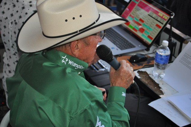 Hadley Barrett in action in the announcer's booth at Denver's National Western Stock Show & Rodeo. Photo courtesy of  Tom Harding, TSM via K99 Radio .