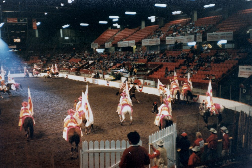 "The Varsity Red Team sets up for the ""Starburst"" maneuver during one of their nightly performances at the Regina Horse Show, 1986"