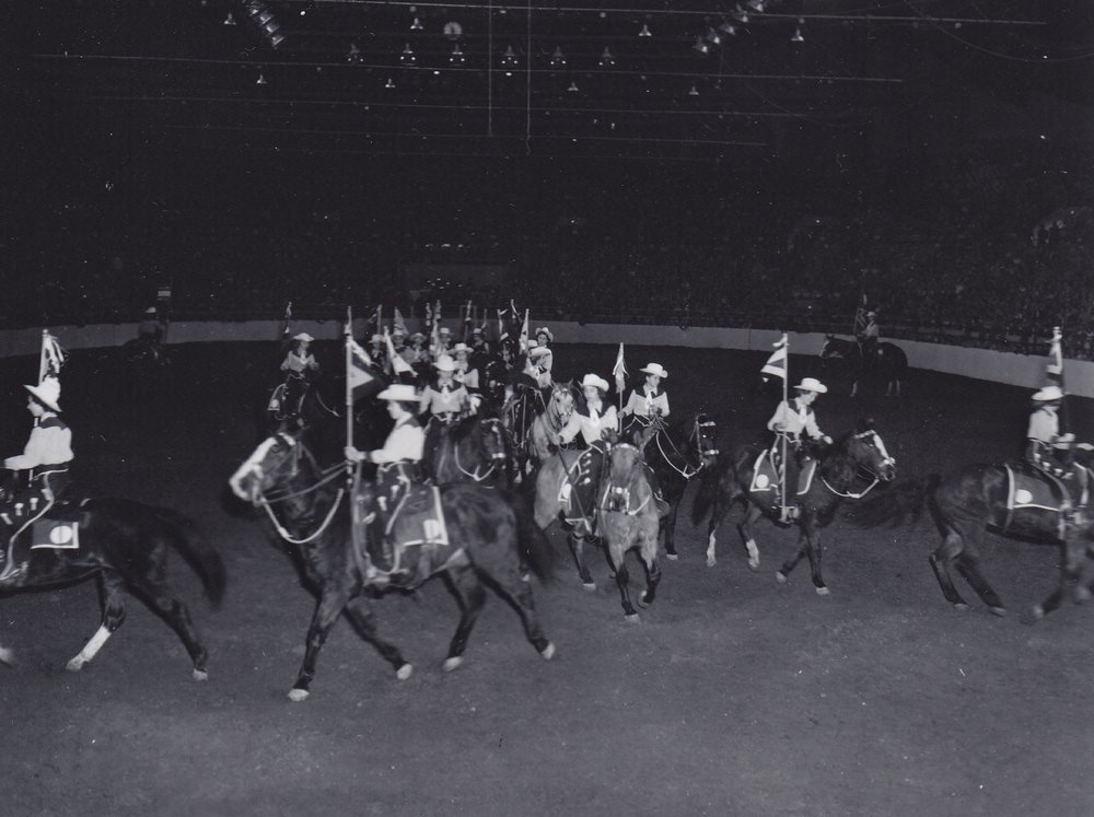 Westernaires split at the rail during their first ever National Western Stock Show performance, in January of 1952