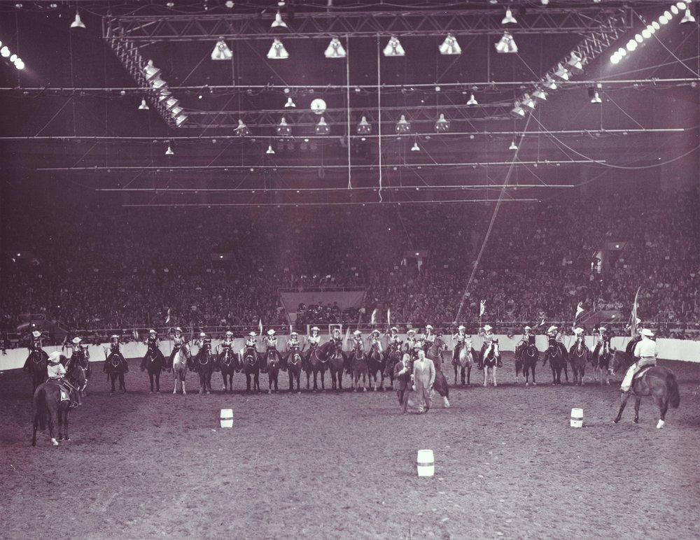 Westernaires perform drill maneuvers and an exhibition of cloverleaf patterns around barrels in the Young Folks Show at the 1952 National Western Stock Show and Rodeo