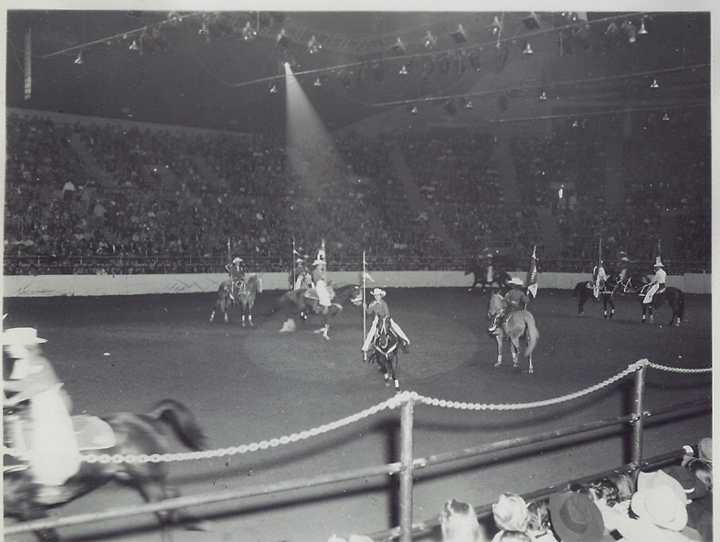 "The Westernaires put in seven appearances at the 1955 National Western Stock Show in Denver. Here, the 30-rider precision drill team executes the ""Gear Wheels"" maneuver."