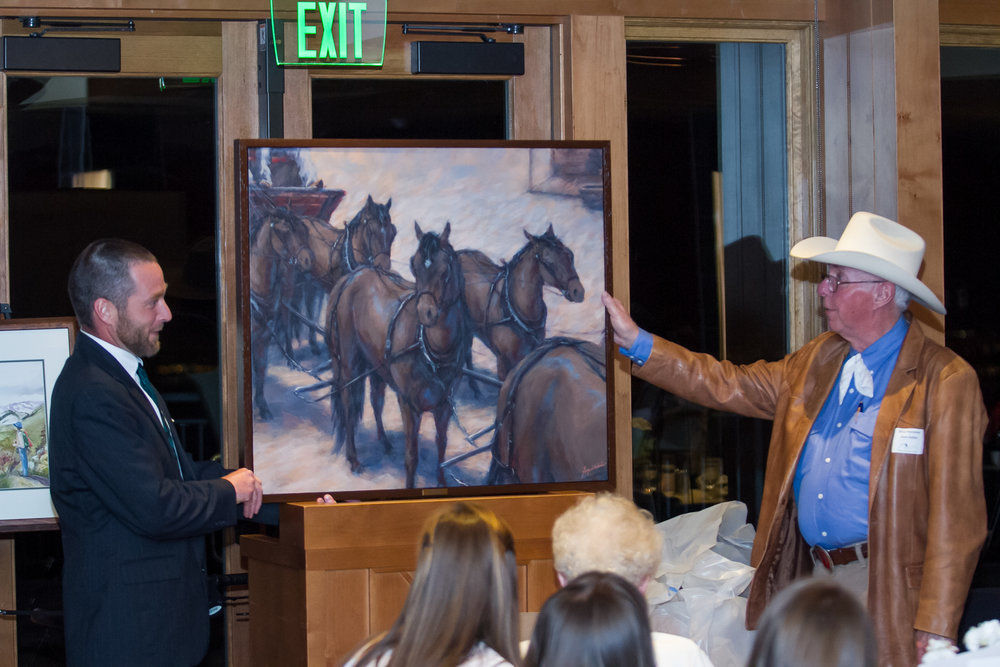 Alumnus Greg Whitaker and Director Glen E. Keller, Jr. with Greg's art portraying a matched team of horses.