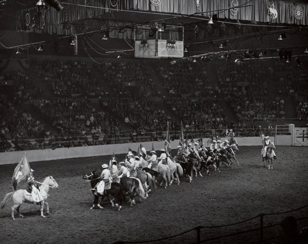 """The Westernaires """"Propeller"""" maneuver spins at speed at the 1961 National Western Stock Show."""