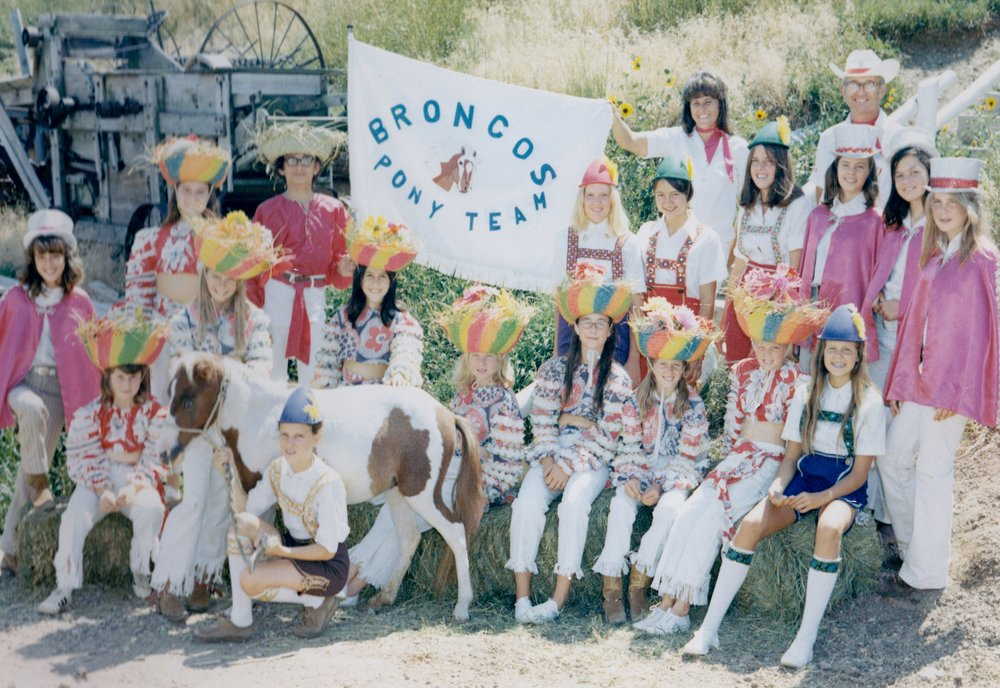 "The Broncos pony teams pictured together in 1972.  There are actually three sub-teams herein.  The ""Caribbeanaires"" sat astride the ponies.  The ""Little Wheels"" drove ponies in front of their two-wheeled carts.  Pony Roman riders (dressed in lederhosen) rode in roman-style, standing on two ponies.  In 1974's ""Horsecapades"" Annual Show, all three pony groups were shown together in the act called ""Pony Galaxy""."
