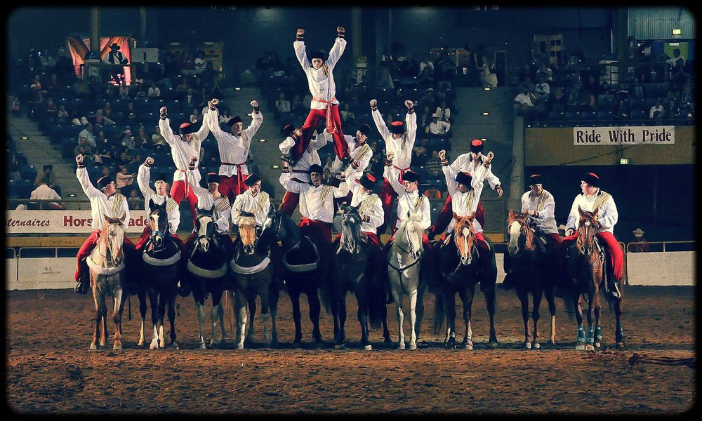Westernaires Riders of the Steppes perform their famed 18-man pyramid at the 2012 Horsecapades annual show.