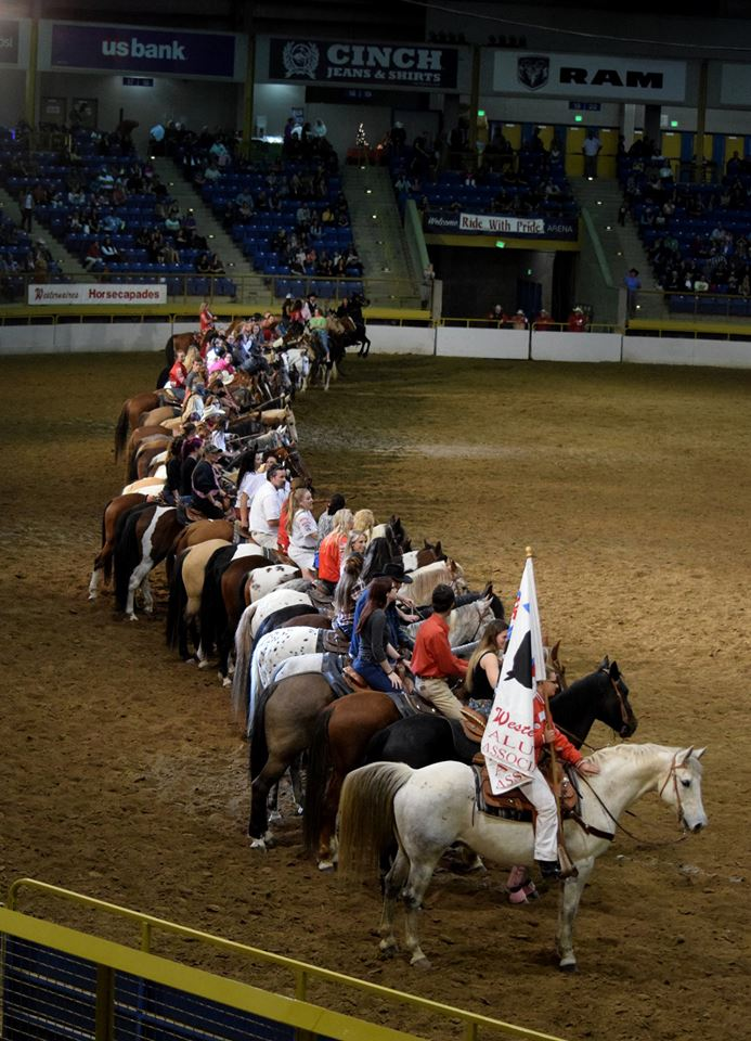Westernaires Alumni ride line up in the arena at the 2017 Horsecapades.