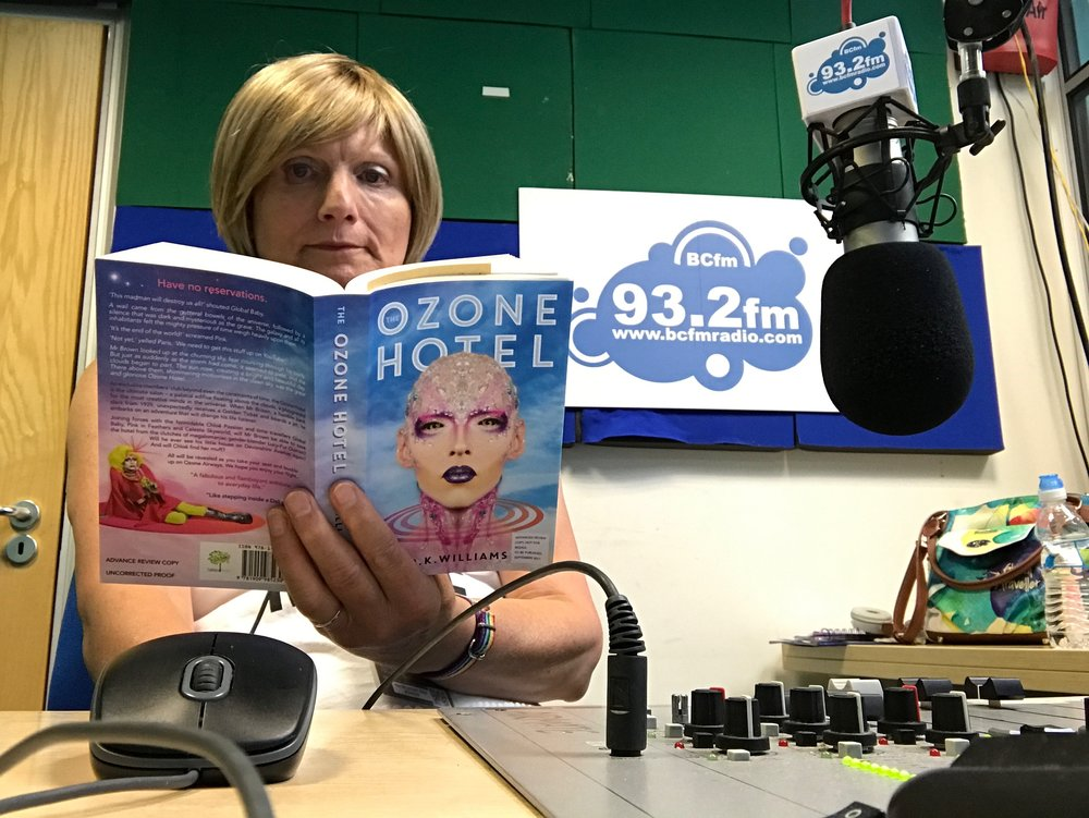 ShoutOut Radio's Steff Barnett enjoying reading her copy of The Ozone Hotel during a break in the studio.