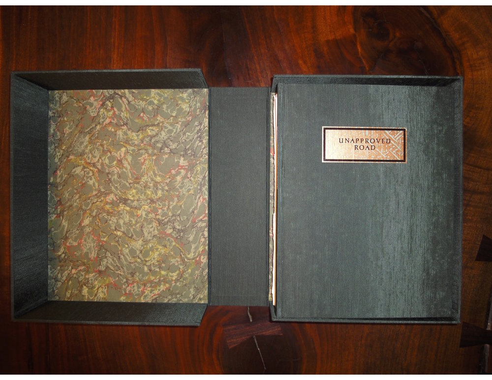 The Morgan Library's copy of Paul Muldoon's  Unapproved Road,  including the press's archive.