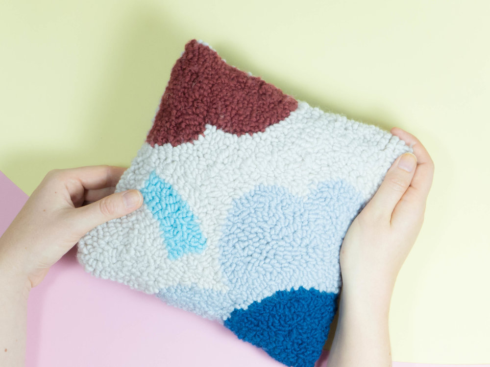 A cushion is just one example of what you can create using your punch needle.