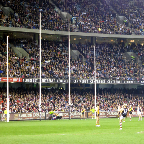 Goal posts in Aussie rules. The inside two are the  goal posts . The outside posts are the  point posts