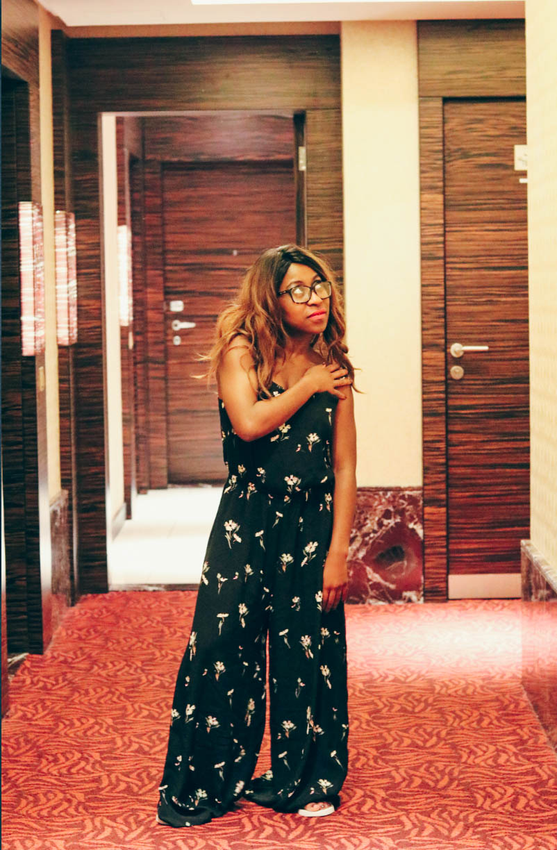 The Atana Hotel Dubai Hallway with me standing and posing in the hallway wearing Elora jumpsuit by Weekday.